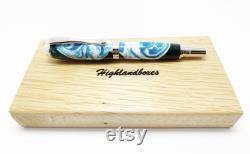 Boule à rouleaux en bois stabilisée et teint ou stylo-plume.